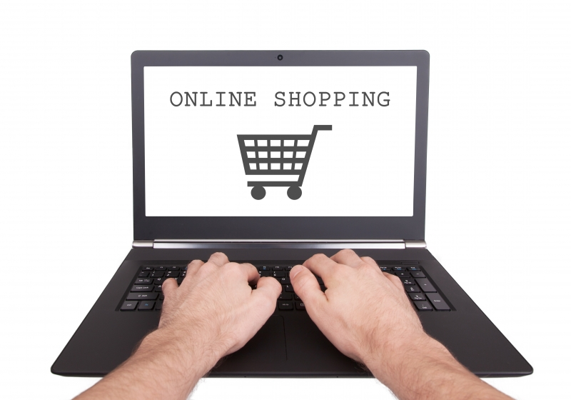 10584618-man-working-on-laptop-online-shopping